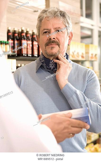 Customers In Pharmacy, Munich, Bavaria, Germany