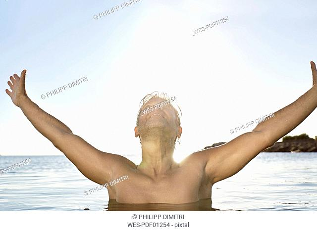 Happy mature man in the sea
