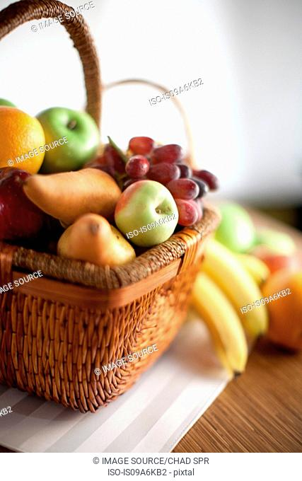 Basket of fruit on table