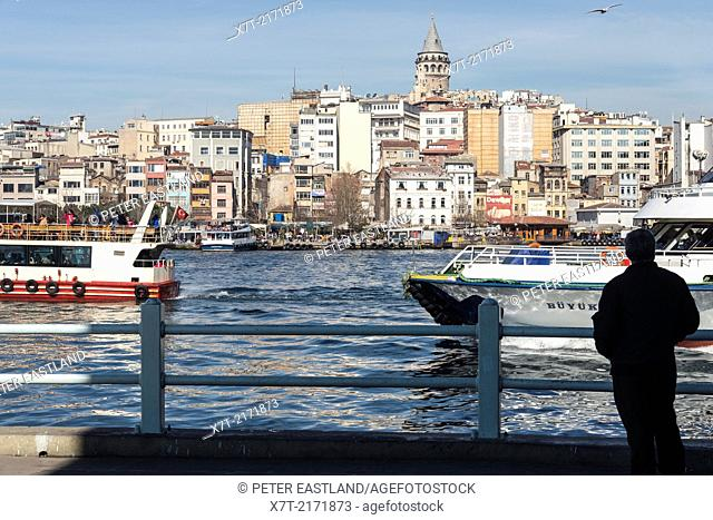View from Galata bridge with ferries on the Golden Horn. Beyoglu and the Galata tower in the background. Istanbul, Turkey