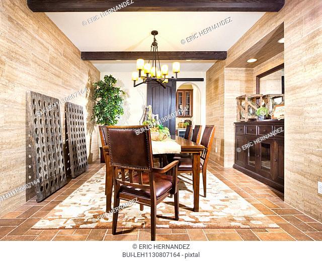 Chandelier over dining table; Valencia; California; USA