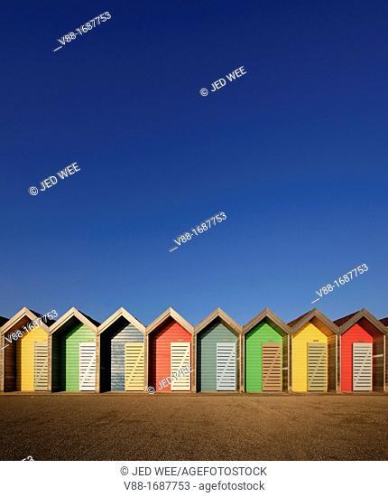 Colourful beach huts along the seafront promenade at Blyth, Northumberland, England