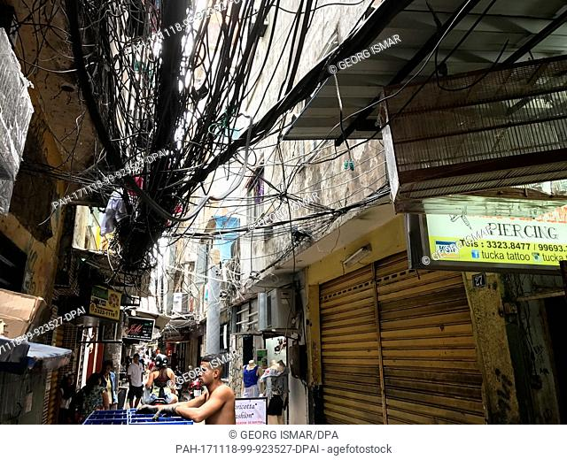 Street scene with a chaotic mess of cables from one of the largest favelas, Rocinha, in Rio de Janeiro, Brazil, 07 November 2017