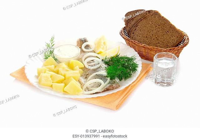 Herring, potato shot glass of vodka and the bread
