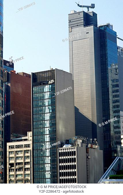 long view of upper floors of commercial buildings at Central, Hong Kong