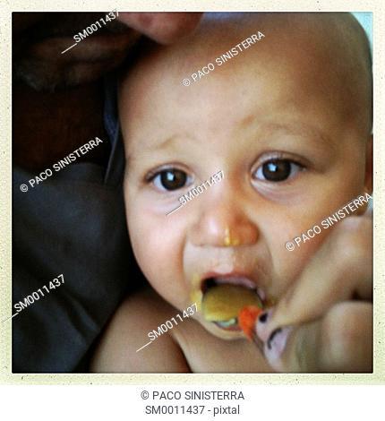 Bebe eating porridge, Valencia, Spain