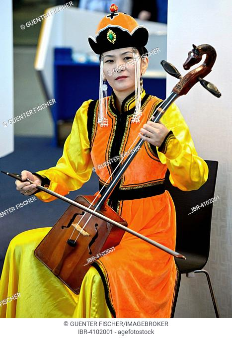 Mongolian musician is playing the horse-head fiddle or Morin Khuur, also Morin Chuur, Mongolia