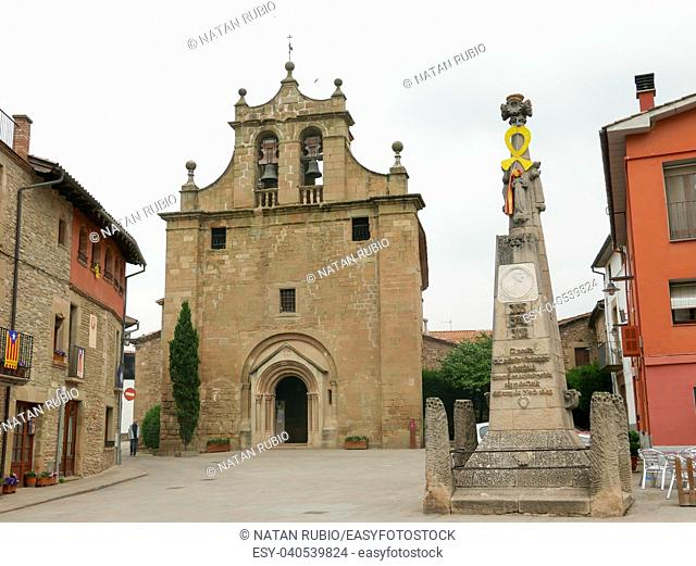 Facade of the church of Folgueroles (Osona) and monument to the poet and priest Jacinto Verdaguer. Catalonia, Spain