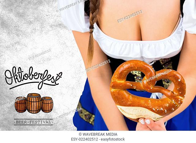 Composite image of oktoberfest girl bending and showing pretzel