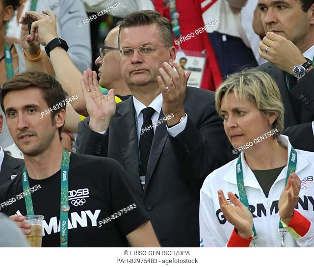 President of the German Football Association (DFB) Reinhard Grindel (C) applauds in the stands during the Men's soccer Gold Medal Match between Brazil and...