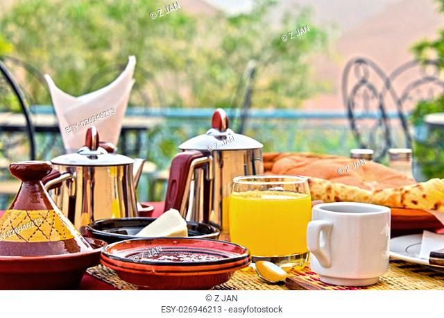Moroccan breakfast served on hotel terrace in Atlas Mountains