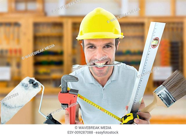 Composite image of happy worker with various equipment