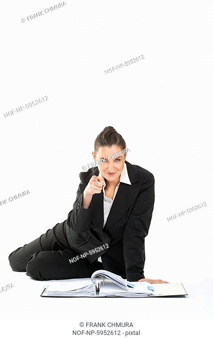 Businesswoman in suit pointing at the camera