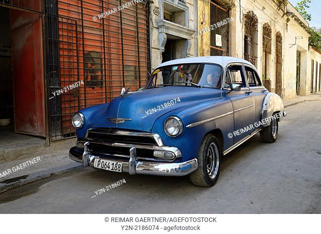 Antique Chevrolet taxi looking for a fare in Old Havana Cuba