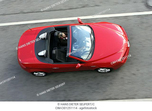 Alfa Romeo Spider 2.2 JTS Exclusive, model year 2007-, red, driving, standing, upholding, diagonal from above, country road, open top