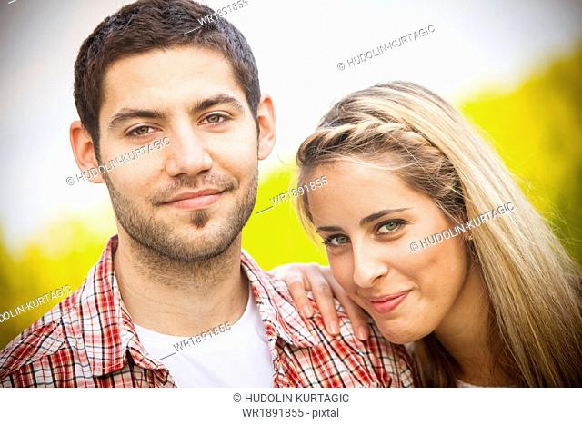 Happy young couple, portrait, Tuscany, Italy