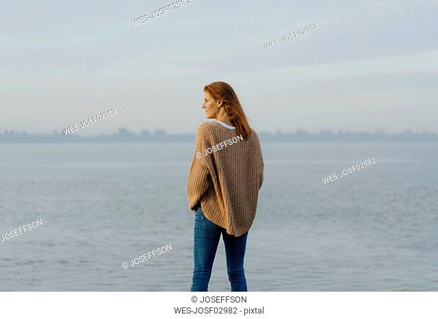 Germany, Hamburg, woman standing at the Elbe shore