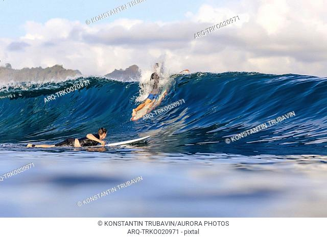 View of two men having fun surfing in sea