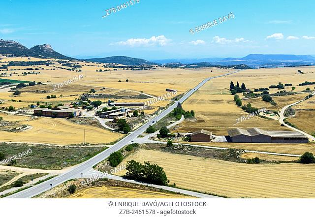 A long road high view closed to Cubells town, Lerida province, Spain