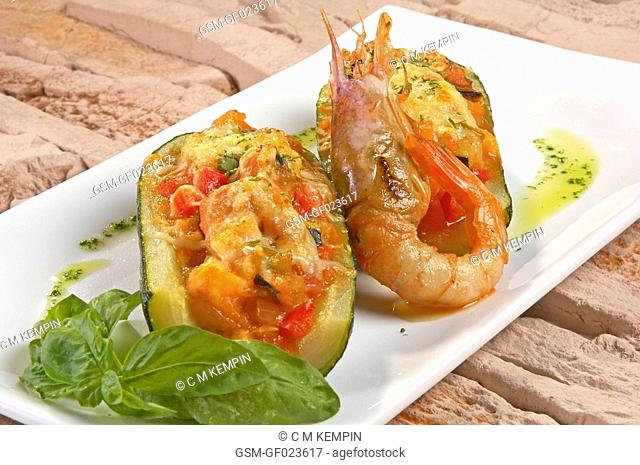 Courgettes stuffed with prawns and fish with basil