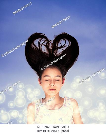 Mixed race girl with heart-shaped hair