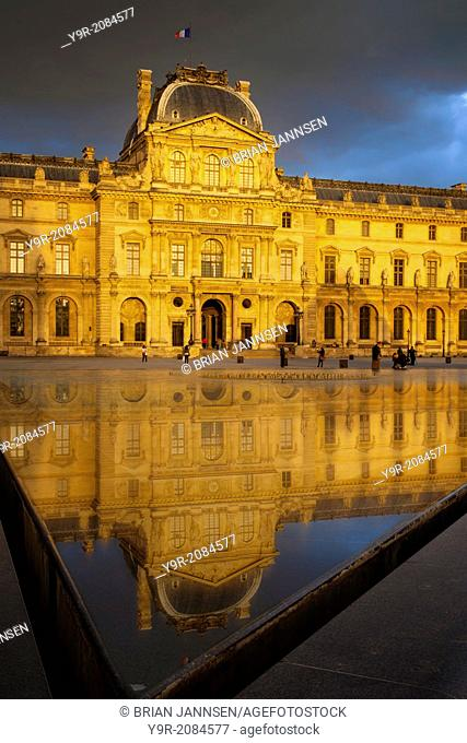 Setting sunlight and reflections at Musse du Louvre, Paris France