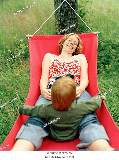 Mother and daughter in a hammock, Atvidaberg, Sweden