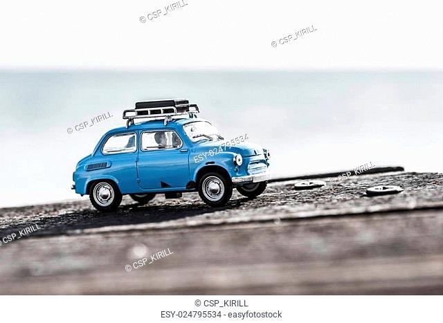 Cute blue retro travel car with luggage. Macro photo