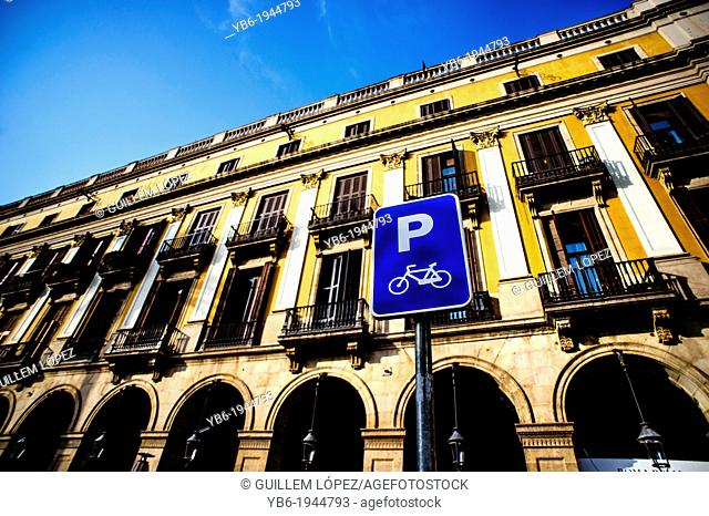 A parking sign for bikes at the 'Plaza Real' of Barcelona, Spain