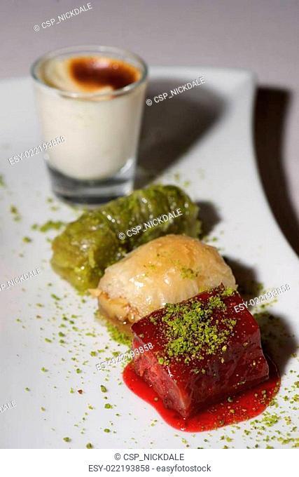 Turkish dessert selection on white china plate