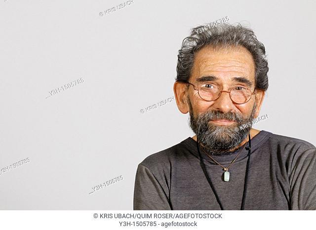 Studio shot of senior man, looking at camera