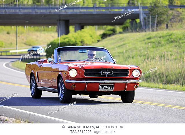 Salo, Finland. May 18, 2019. Classic 1960s red Ford Mustang convertible on the road on Salon Maisema Cruising 2019. Credit: Taina Sohlman/agefotostock