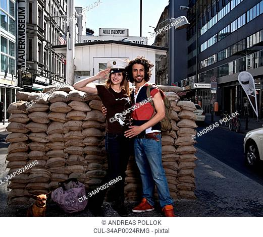 Couple smiling at Checkpoint Charlie