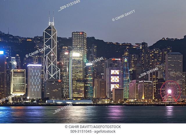Skyscrapers on Hong Kong Island skyline with the Bank of China and Hong Kong Shanghai Bank at twilight seen from Tsim Sha Tsui, Kowloon, Hong Kong, S