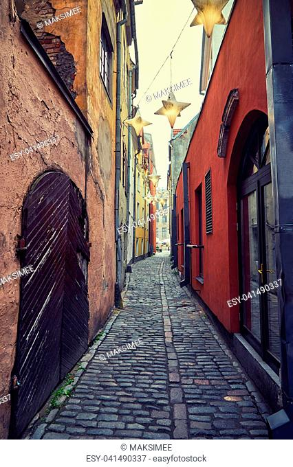 A narrow European street in the center of the old town in Riga, Latvia