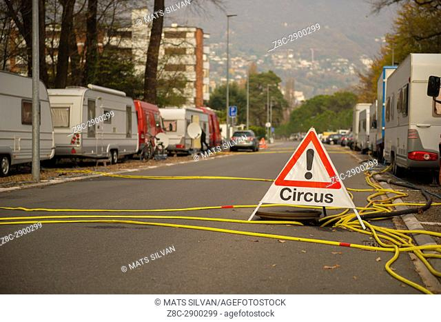 Street with Caravans and Circus Signboard in Ticino, Switzerland