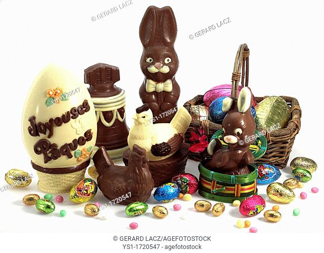 Chocolate Bell, Rabbit, Hen and Eggs for Easter against White Background CH