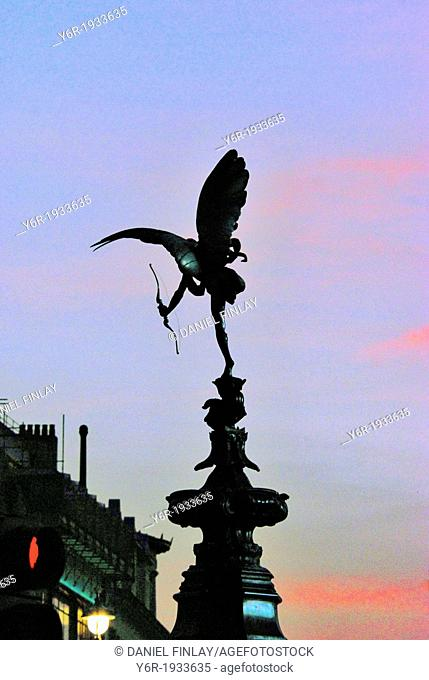 Statue of Eros in Piccadilly Cicus, seen looking westwards down Piccadilly, against a pleasant sunset, on a Spring evening in London, England