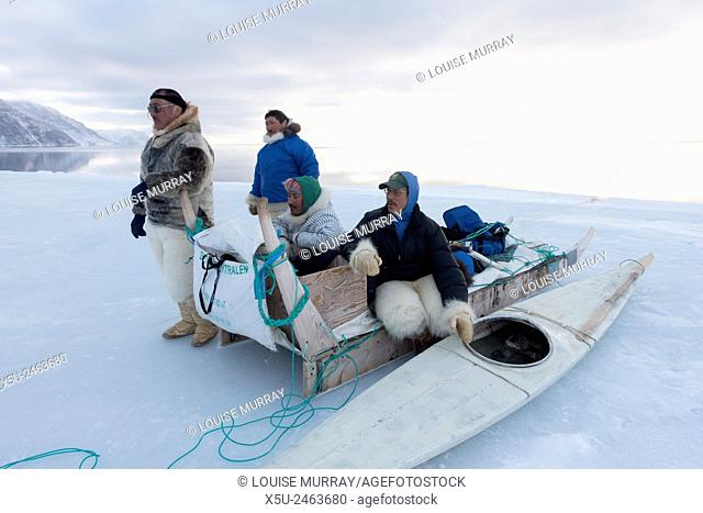 Group of Inuit or Inughiut hunters from Qaanaaq, greenland at the floe edge in Hvalsund,