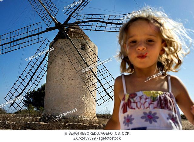 Funy girl in the windmill, Formentera, Balearic Islands, Spain. Old Windmill in el Pilar de la Mola on the island Formentera, Balearic Islands, Spain