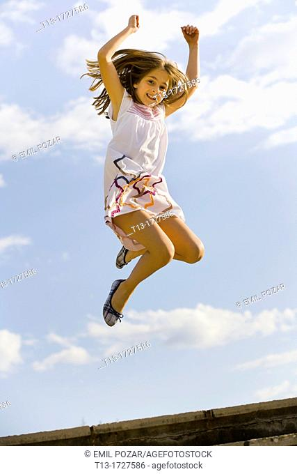 Young girl caught in mid-air