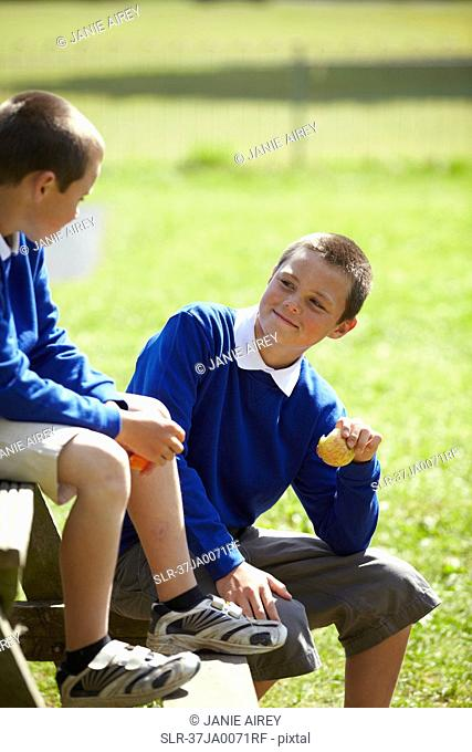 Students eating together outdoors