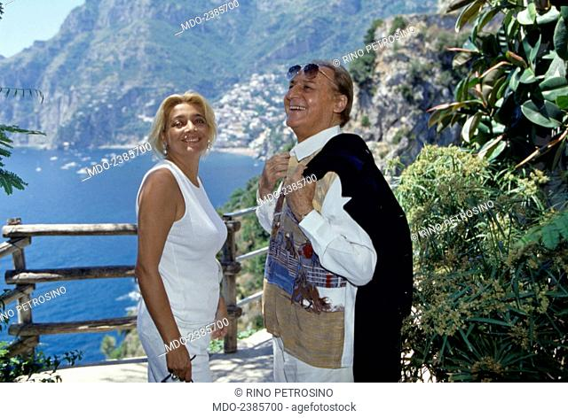 Italian singer-songwriter, radio host and showman Renzo Arbore smiling with italian TV presenter and actress Mara Venier (Mara Provoleri) in front of the gulf...