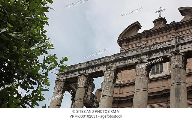 CU, PAN, LA. Daylight. Exterior: The temple was built by Emperor Antoninus Pius in 141 AD. The facade is preceded by a long stairway with an altar in the center