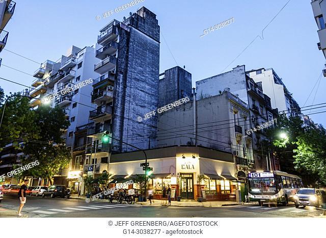 Argentina, Buenos Aires, Recoleta, Cala Pizza y Bar Recoleta, restaurant, evening night nightlife, skyline, dusk, street corner, bus, light streaks, Hispanic