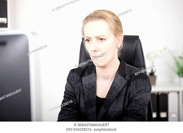 Close up Pensive Adult Office Woman in Black Business Attire Looking at the Computer Screen Seriously