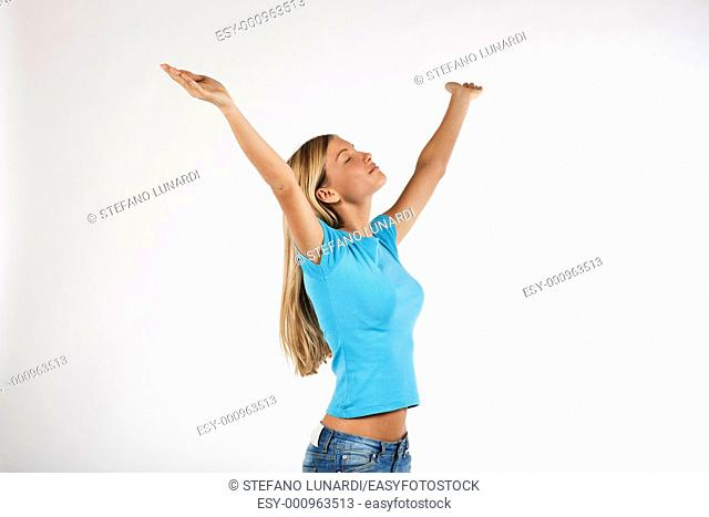 Beautiful young woman with arms raised, isolated on white