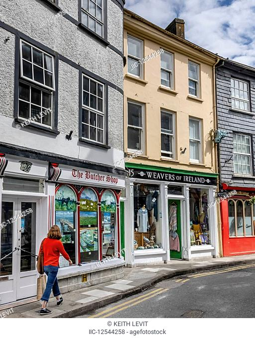 Female tourist shopping in an Irish town; Kinsdale, County Cork, Ireland
