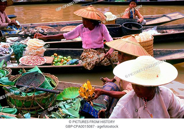 Burma / Myanmar: Intha women vendors at the floating market, Inle Lake, in Shan State