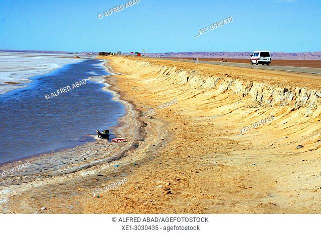 road and salt lake, Chott El Jerid, Tunisia